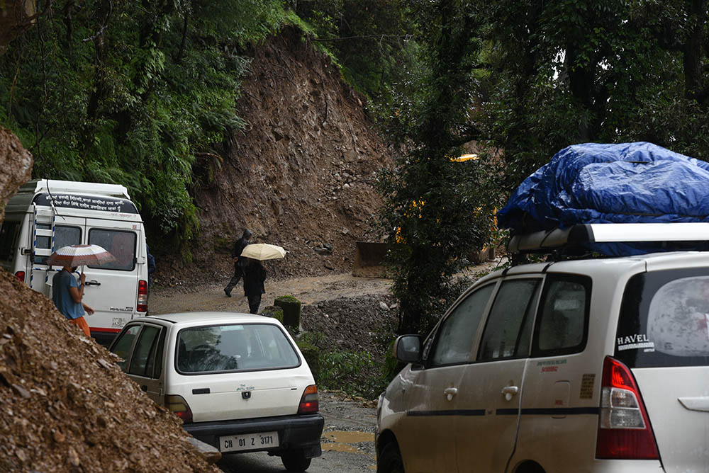 Waiting for a landslide to be cleared, a typical monsoon scene on the roads of Himachal Pradesh