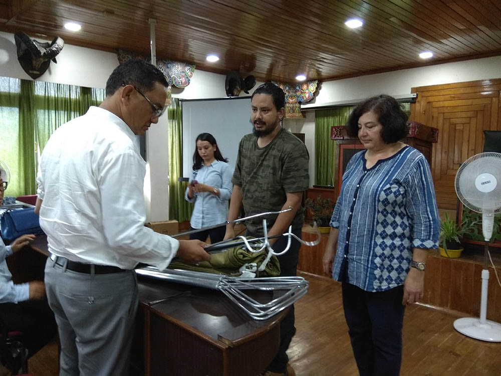 Dr Anita Malhotra and Vishal Santra presents  Shri Bhuwan Pradhan, the Sikkim Chief Conservator of Forests (Wildlife) with specially made sets of snake handling equipment