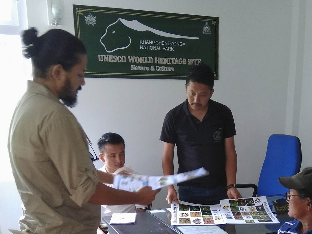 The Divisional Forest Officer in Yuksom, West Sikkim, being presented with posters depicting local venomous and non-venomous snakes